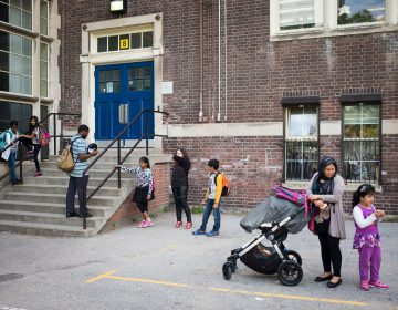 Families wait for students outside Rose Avenue Public School in Toronto, Ontario, Canada. (Ian Willms/For Keystone Crossroads)