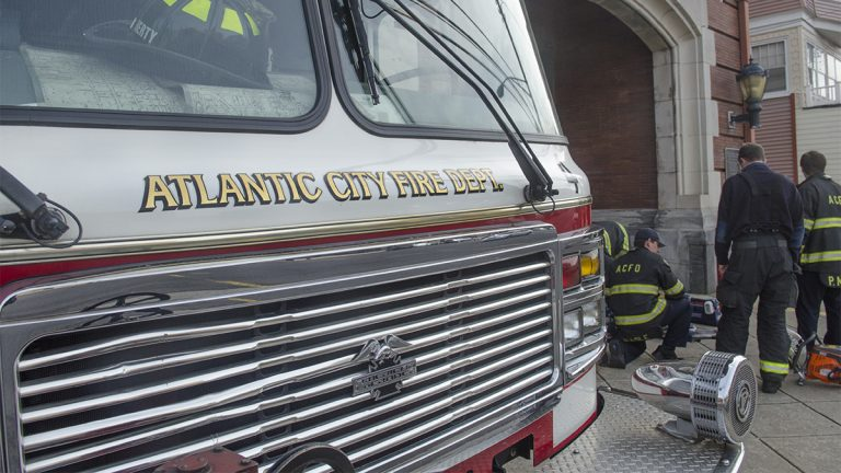 Atlantic City firefighters from Station 4,  Engine 4, Ladder 2, California Ave. prepare for duty. (Anthony Smedile for NewsWorks)