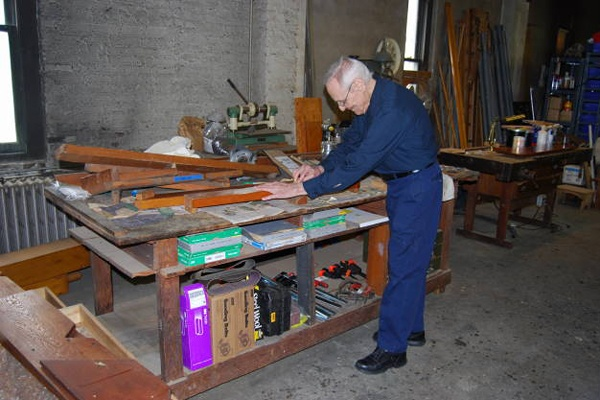<p><p>Buddy Grover, 84, works to restore a piece of the organ.  (Mary Cummings Jordan/WHYY)</p></p>