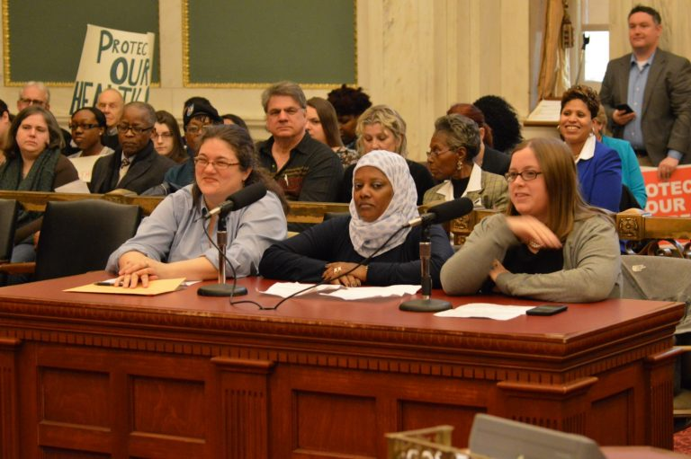 Homecare worker Kaliena Stewart (center) testifies at hearing Monday before a City Council panel. (Tom MacDonald, WHYY)