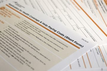 This file photo shows the short form for the federal Affordable Care Act application. (AP Photo/J. David Ake)