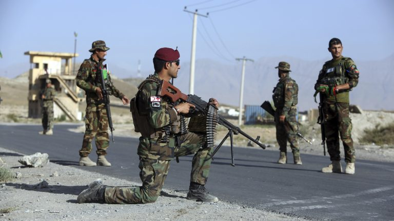 Afghan national army (ANA) Soldiers stand guard at a checkpoint on the outskirts of Kabul, Afghanistan, Monday, Aug. 21, 2017. President Donald Trump will use a nationally televised address to outline for a war-weary nation the strategy he believes will best position the U.S. to eventually declare victory in Afghanistan after 16 years of combat and lives lost. (AP Photo/Rahmat Gul)