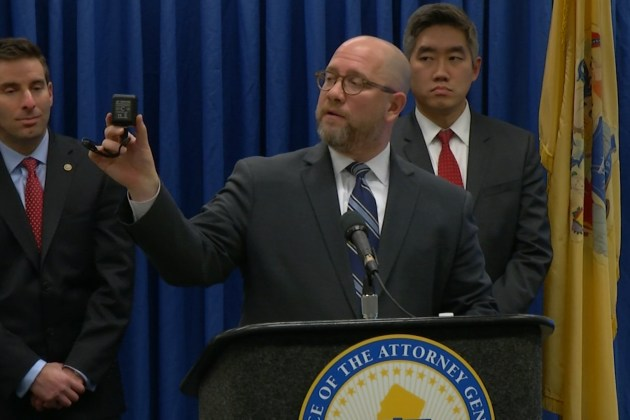 New Jersey Attorney General Chris Porrino showing one of the cameras the office lends out to those wishing to keep tabs on those caring for elderly relatives (New Jersey Department of Consumer Affairs)