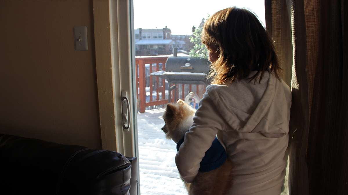 Suellen Kehler looks out on a snowy landscape from her Northeast Philadelphia rowhome. When the neighbors found out she was HIV positive, some told their children to stay away.