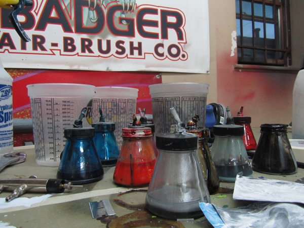 "<p><p>Paint jars in Freddy Sicoli's airbrush studio on South Chadwick Street in Philadelphia. (Peter Crimmins/NewsWorks)<span style=""font-size: 12pt; font-family: Cambria;""><br /> <br /> <br /> </span></p></p>"