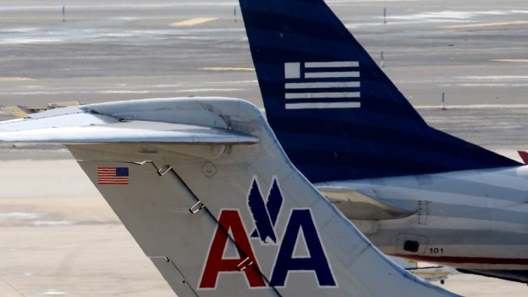 American Airlines and US Airways jets prepare for flight at gate at the Philadelphia International Airport. (AP Photo/Matt Rourke)