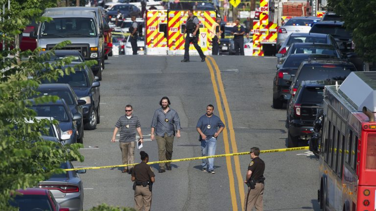 Police and emergency personnel are seen near the scene where House Majority Whip Steve Scalise of Louisiana was shot during a Congressional baseball practice in Alexandria, Va., Wednesday, June 14, 2017.  (AP Photo/Cliff Owen, file)
