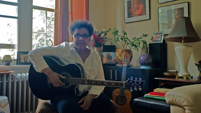 Monnette Sudler talks about her music and her life in her apartment in Germantown.  (Alex Lewis for NewsWorks)