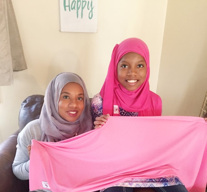 Ameenah Muhammad Diggins (Left) poses with her 10-year-old daughter, Amaya, at their home in Burlington County. Amaya has started a company that creates hijabs for little girls. (Ameenah Muhammad Diggins)