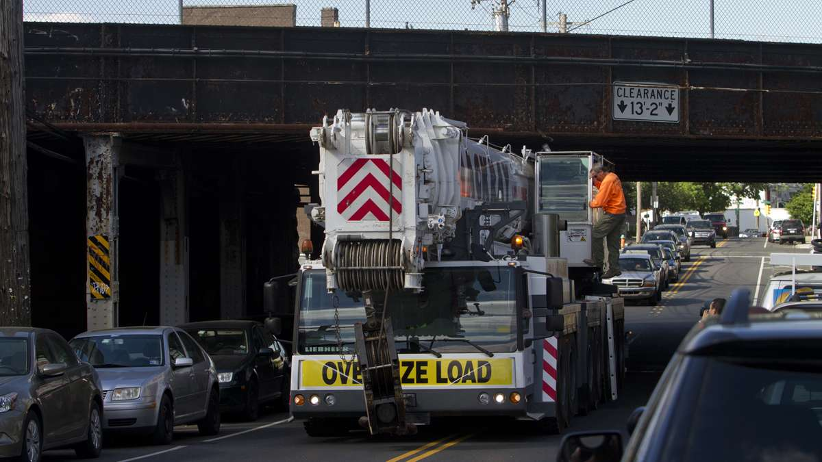 Emergency personnel bring in a crane to move the derailed Amtrak train near Port Richmond in North Philadelphia Wednesday morning.