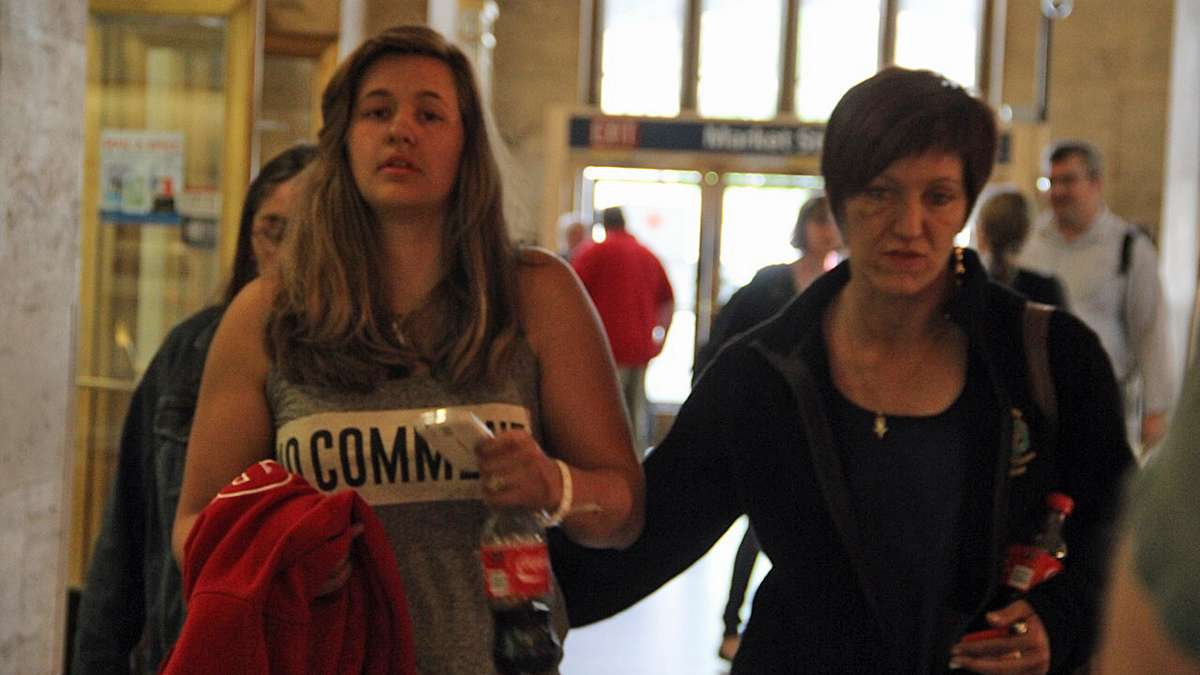 After a harrowing night that included an emergency room visit, derailment survivors take refuge at 30th Street Station