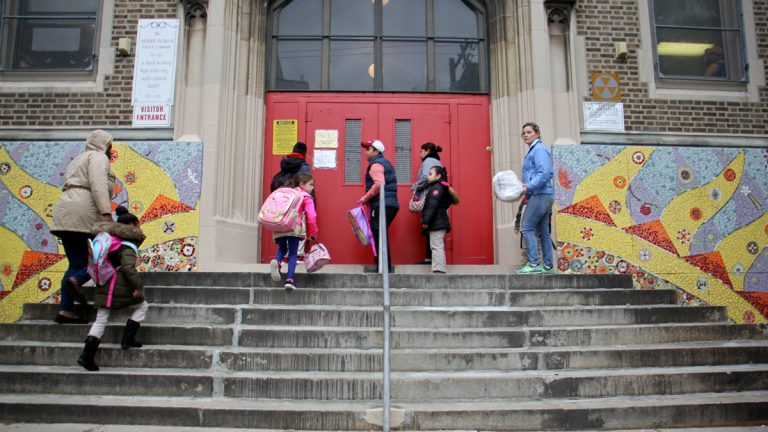 Students arrive at Andrew Jackson Elementary School for the start of the school day. (Emma Lee/WHYY)
