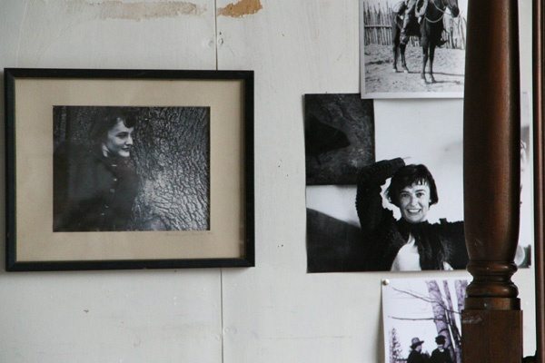 Snapshots of Andrew Wyeth's wife, Betsy, are pinned to his studio wall, as they were during his life. (Emma Lee/for NewsWorks)