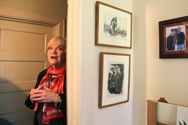 Tour guide Mary Nell Ferry prepares visitors for the