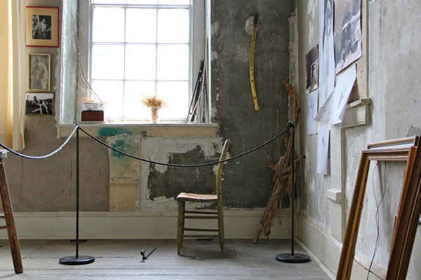 Andrew Wyeth's studio contains treasured possessions, family photographs, and unfinished sketches as well as brushes and paints. (Emma Lee/for NewsWorks)