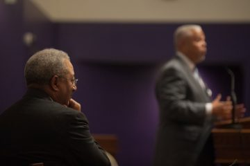 Rev. William B. Moore of Tenth Memorial Baptist Church listens to Anthony Hardy Williams speak during a campaign rally at Greater Saint Matthew Baptist Church in North Philadelphia Sunday evening, May 17, 2015.
