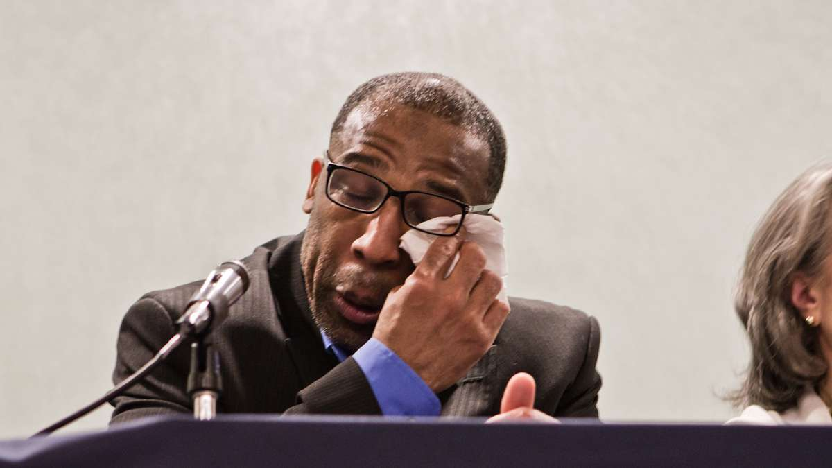 Anthony Wright, 45, was acquitted of a murder conviction, and release from prison after 25 years Tuesday. Wright wipes away tears during a press event (Kimberly Paynter/WHYY)