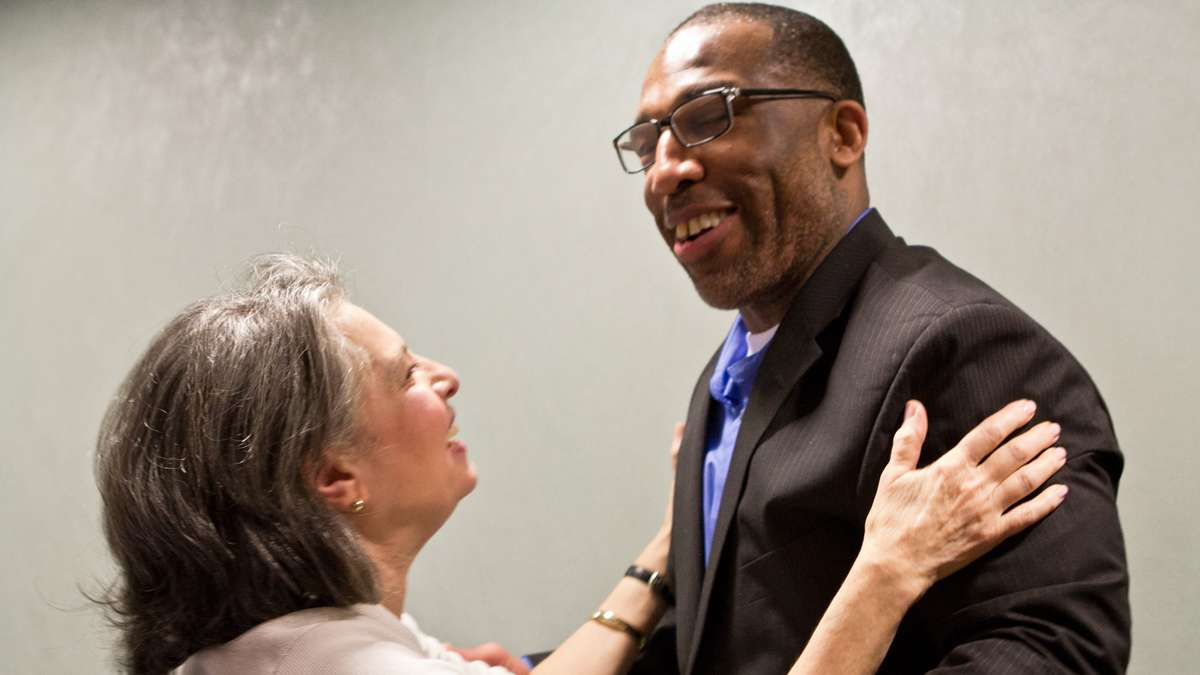 Anthony Wright embraces Rose Greco, a juror at Wright's second trial who voted to set him free. (Kimberly Paynter/WHYY)