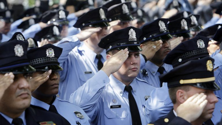 Police officers salute as the casket of casket of Philadelphia police Officer Sgt. Patrick McDonald, 30, as it is taken from Cathedral Basilica of Saints Peter and Paul after funeral services in Philadelphia in 2008. McDonald was fatally shot as he chased a man on foot after a traffic stop. (AP file photo)