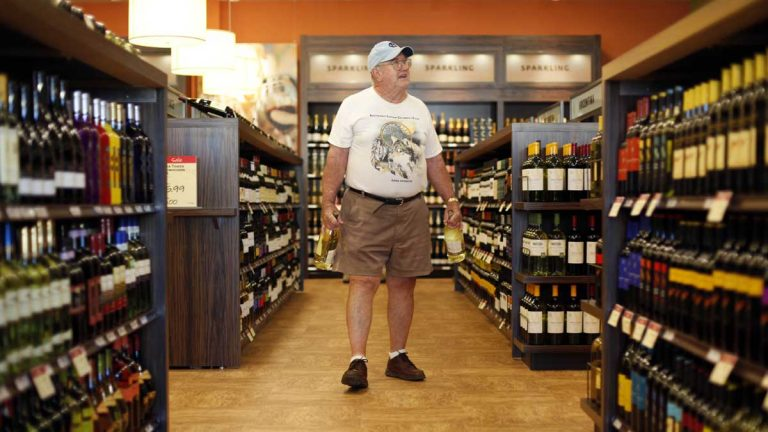 in 2010, Jay Petrie of Solebury Pennsylvania, shops at a state wine and liquor store in New Hope. By a vote of 114-87, the Pennsylvania House has passed a proposal to take apart the state's liquor system, though the measure is not expected to advance. (AP file photo)