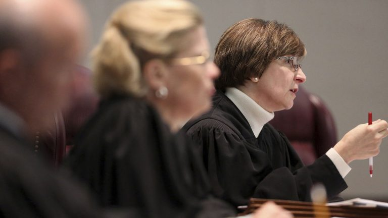 Justices on New Jersey Supreme Court, pictured earlier this month, are reviewing the extent of the state's whistleblower law. (AP Photo/The Record of Bergen County, Chris Pedota, Pool)