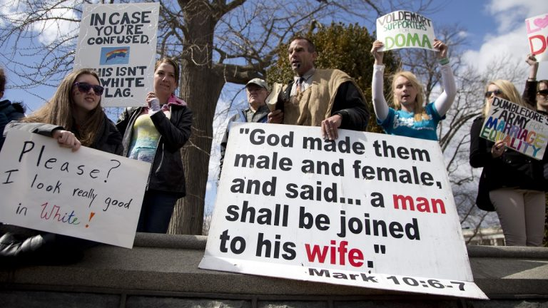 When the U.S. Supreme Court heard arguments in the Defense of Marriage Act (DOMA) case in March, both sides of the issue made their opinions known across the street. (AP Photo/Carolyn Kaster)