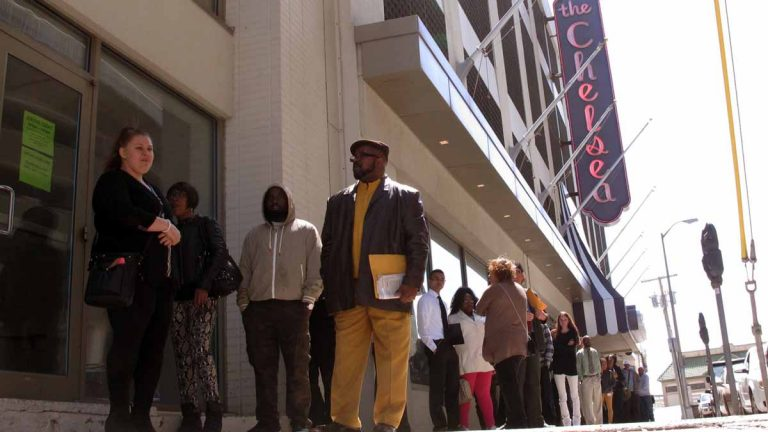 Ronald Roberts, right, waits at the head of the line of applicants for jobs at the Chelsea hotel in Atlantic City last month. Roberts lost his cook's job last August when the Showboat casino closed. Many laid-off casino workers were among those seeking jobs at the Chelsea, even three-month temporary seasonal positions. (AP Photo/Wayne Parry)