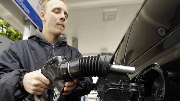 Attendant James Lewis pumps gas at a station in Portland, Oregon, last month. Oregon and New Jersey are the only states where motorists aren't allowed to pump their own gas.  Now the Oregon Legislature appears ready to at least let people driving through rural Oregon pump their own. (AP Photo/Don Ryan)