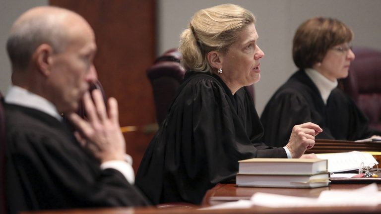 New Jersey Supreme Court justices listen to arguments in January. The court has ruled New Jersey did not break the law when it eliminated state-funded Medicaid benefits for legal immigrants who have been in the country  fewer than five years. (AP file photo)