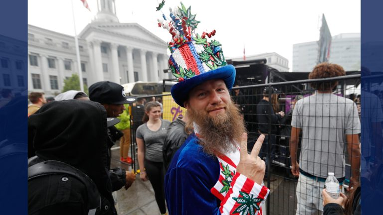 Marijuana enthusiast flashes a peace sign as he waits to go on the stage light up at the 4/20 holiday on Thursday, April 20, 2017, in Denver's Civic Center Park. The annual celebration of cannabis culture attracted users from across the intermountain West to Denver.  (David Zalubowski/AP Photo)