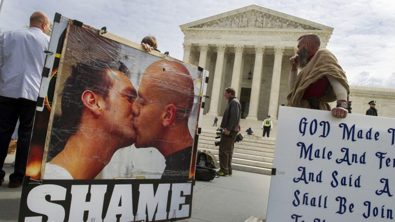 Anti-gay marriage protestors demonstrate in front of the Supreme Court in Washington, Monday, April 27, 2015. The opponents of same-sex marriage are urging the court to resist embracing what they see as a radical change in society's view of what constitutes marriage. (AP Photo/Cliff Owen)