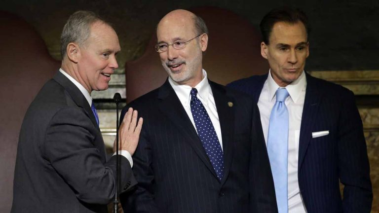 Pennsylvania Gov. Tom Wolf, center, speaks with Speaker of the House of Representatives, Rep. Mike Turzai, R-Allegheny, left, as Lt. Gov. Michael Stack looks on after Wolf delivered his budget address for the 2015-16 fiscal year. Wolf  praised the House Wednesday for passing a property tax-overhaul plan. (AP file photo)