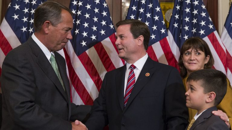 Speaker of the House Rep. John Boehner, R-Ohio, left, shakes hands with U.S. Rep. Donald Norcross, D-N.J., center, during a ceremonial swearing-in ceremony on Capitol Hill in November.  (AP Photo/Evan Vucci)