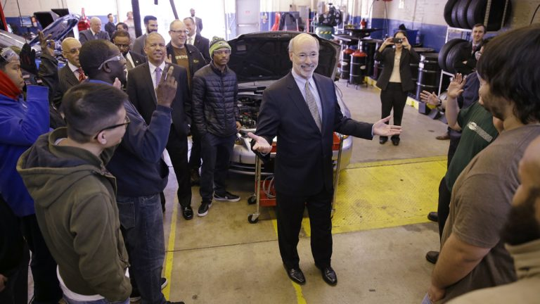 Gov. Tom Wolf visits Professor Dan Reed's automotive service technology class at the Community College of Philadelphia. The governor's budget talks with the Republican-controlled Legislature may stall before they start.(AP Photo/Matt Rourke)
