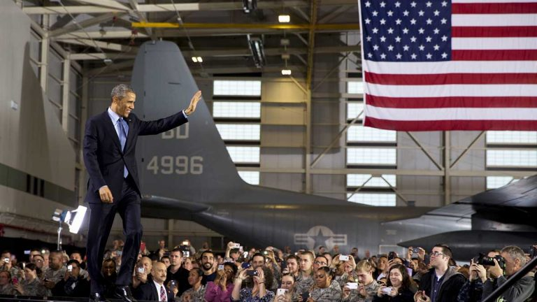 President Barack Obama waves to troops and their families assembled at Joint Base McGuire-Dix-Lakehurst in December. The Pentagon could trim operations at the installation in Wrightstown, New Jersey. (AP file photo)