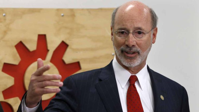 Pennsylvania Gov. Tom Wolf says he stands by his nominee to lead the state police force, Marcus Brown, despite some criticism from former troopers. Brown will appear before a state Senate panel Wednesday. (AP file photo)
