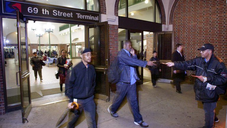 Commuters exit SEPTA's 69th Street terminal (George Widman/AP Photo)