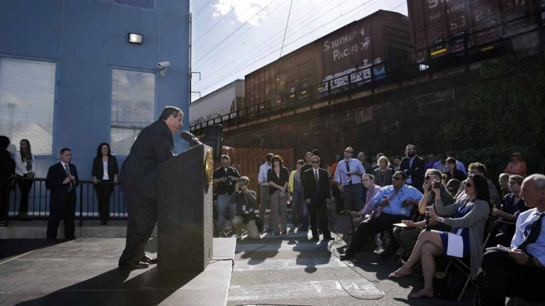 New Jersey Gov. Chris Christie addresses a gathering after an outdoor bill signing ceremony Wednesday in New Brunswick. (AP Photo/Mel Evans)