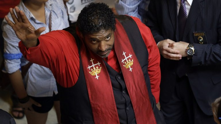 Rev. William Barber, president of the N.C. chapter of the NAACP speaks to supporters at the state legislature in Raleigh, N.C., Monday. Supporters of what the group calls