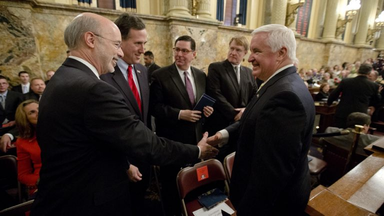 Democratic Gov.-elect Tom Wolf, left, shakes hands with Gov. Tom Corbett, right, as former U.S. Sen. Rick Santorum looks on Tuesday  before newly elected members of the Pennsylvania Legislature were sworn in. The Senate and House chambers both adjourned until Wolf's swearing in Jan. 20. (AP Photo/Matt Rourke
