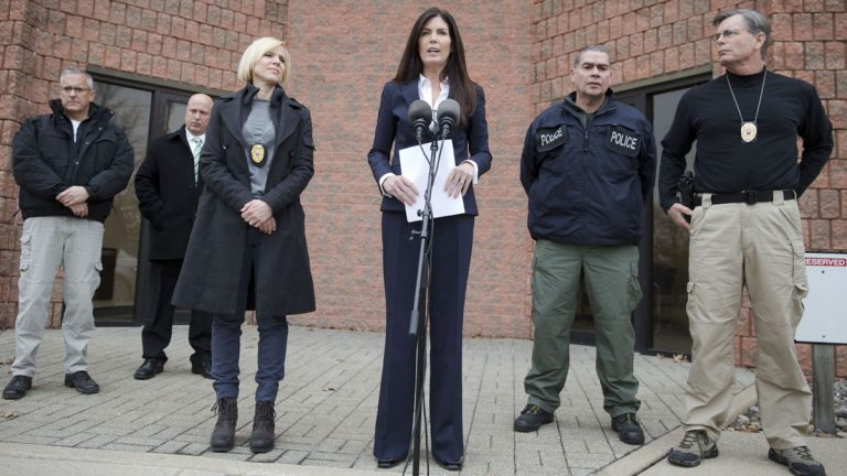 Attorney General Kathleen Kane, center, speaks during a news conference Wednesday in Philadelphia. Court documents released Wednesday show a grand jury has concluded there are reasonable grounds to charge Kane with perjury, false swearing, official oppression and obstruction after an investigation into leaks of secret grand jury material. Kane has proclaimed her innocence. (AP photo/Matt Rourke)