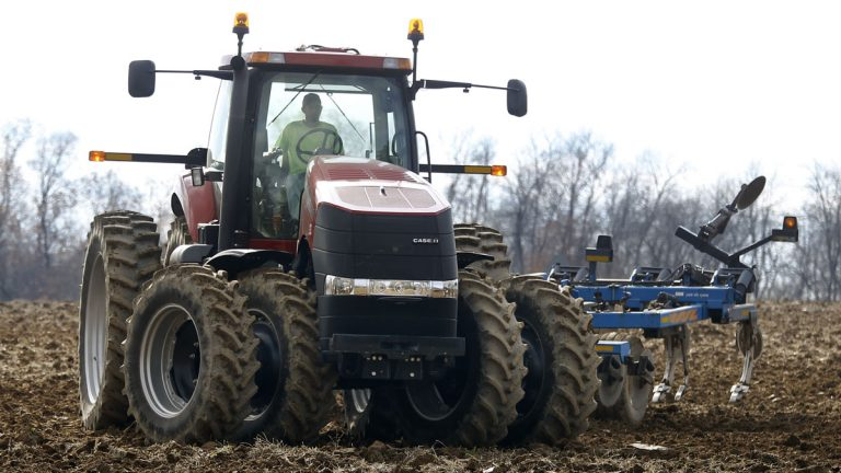 A farmer moves his tractor after turning over the soil in a field on a farm in Prospect, Pennsylvania. (AP Photo/Keith Srakocic)