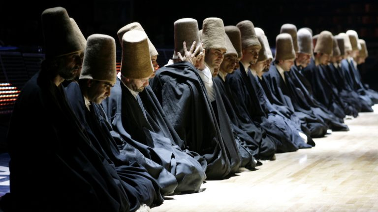 Dervishes pray during a
