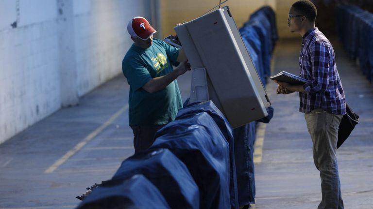 Technicians test a voting machine in advance of balloting in Philadelphia. (AP file photo)