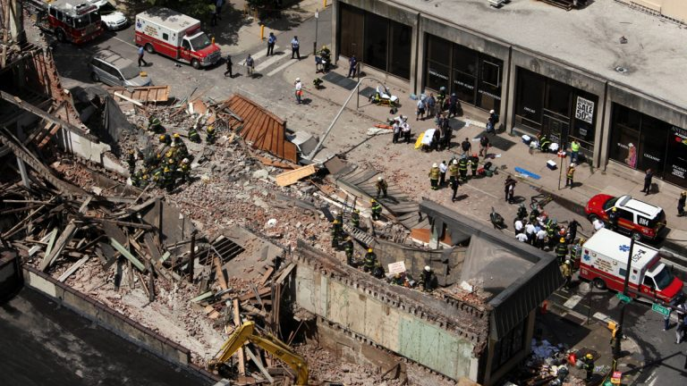 On June 5, 2013,  rescue personnel work the scene of a building collapse on Market Street in downtown Philadelphia that left six people dead and 13 injured. The owner of the building under demolition told jurors he 'realized something fell. I didn't know what it was.' (AP file photo)