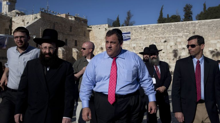 New Jersey Gov. Chris Christie, center, walks at the Western Wall, the holiest site where Jews can pray, during his visit to Jerusalem's old city in 2012. (AP file photo)