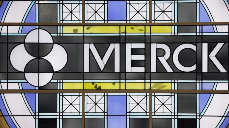 This Thursday, Dec. 18, 2014, file photo shows the Merck logo on a stained glass panel at a Merck company building in Kenilworth, N.J. (AP Photo/Mel Evans, File)