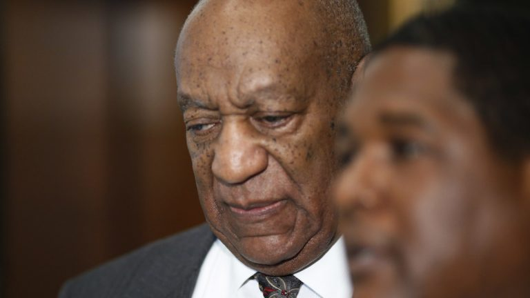 Comedian Bill Cosby leaves the Montgomery County Courthouse after being ordered to stand trail for assault charges