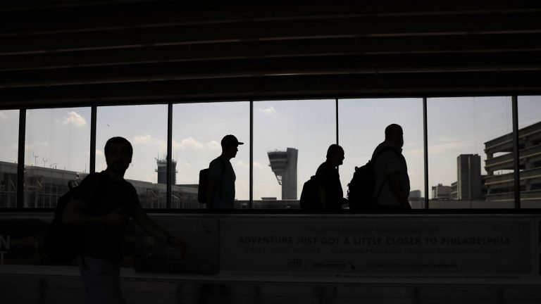 Some workers at Philadelphia International Airportsay they may go on strike while the Democrats are in town for the national convention at the end of the month. Travelers make their way through the Philadelphia International in May. (AP Photo/Matt Slocum)