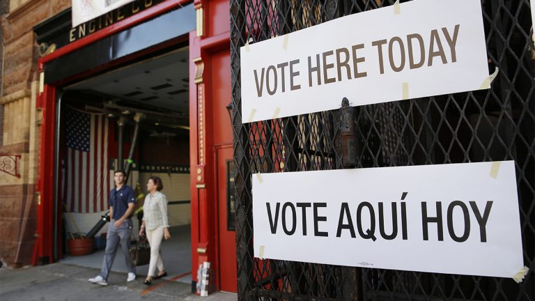 Voters leaves a polling site in a fire station in Hoboken, N.J., Tuesday, June 7, 2016. Hillary Clinton faces off with Bernie Sanders and New Jersey's 12 congressional members are up for re-election in Tuesday's primary. (AP Photo/Seth Wenig)